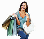 Enthusiastic brunette holding shopping bags