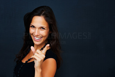 Buy stock photo Woman looking to camera and pointing upwards