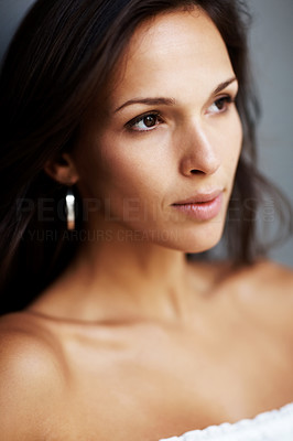 Buy stock photo Closeup portrait of a pretty young woman lost in thought
