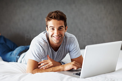 Buy stock photo Portrait of a relaxed young man using laptop at home - Indoor