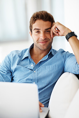 Buy stock photo Portrait of a smiling young guy working on a laptop - Indoor
