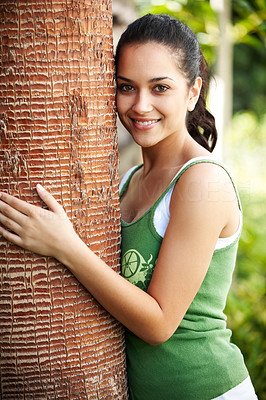 Buy stock photo Portrait of pretty young woman hugging a big tree in a park - Outdoors