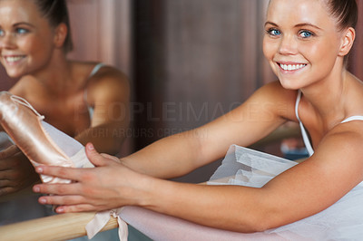 Buy stock photo Closeup portrait of a happy ballet dancer practicing a stretch in front of a mirror