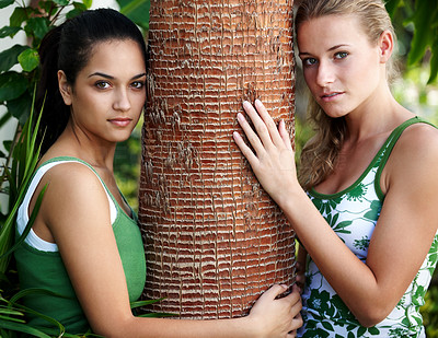 Buy stock photo Portrait of two beautiful teenage girls holding a tree bark in a park - Outdoor