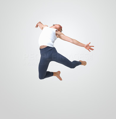 Buy stock photo Full length of a young ballet man jumping high against white background