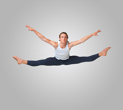 Buy stock photo Full length of a Caucasian young man jumping against white background - copyspace