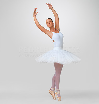 Buy stock photo Full length of a pretty young ballerina performing against white background - copyspace