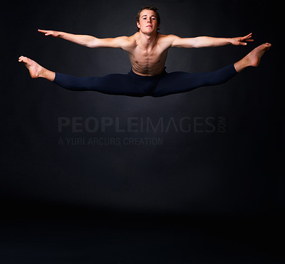 Buy stock photo Full length of a young ballet man jumping energetically against a black background - copyspace