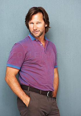 Buy stock photo Portrait of a smart mature man with a confident look against colored background, hands in pockets