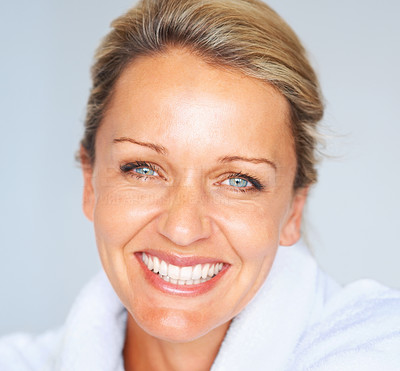 Buy stock photo Detail shot of an attractive mature woman smiling against blue background