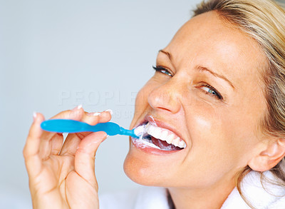 Buy stock photo Closeup portrait of a cheerful mature woman brushing her teeth
