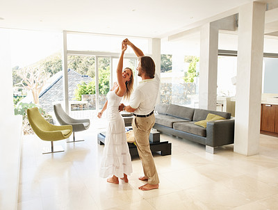 Buy stock photo Romantic mature couple dancing in a spacious modern living room