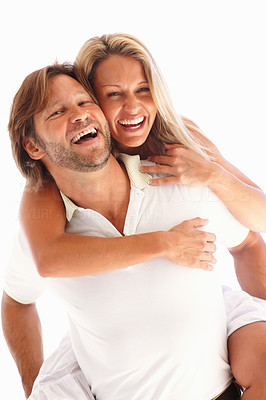 Buy stock photo Cheerful mature man giving happy woman a piggyback ride against white background