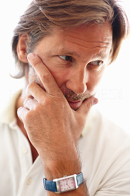 Buy stock photo Closeup portrait of a mature man in deep thought against white background