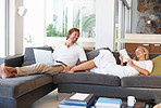 Happy couple having free time together in modern living room