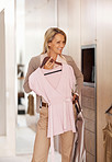 Happy woman selecting what can to dress at home