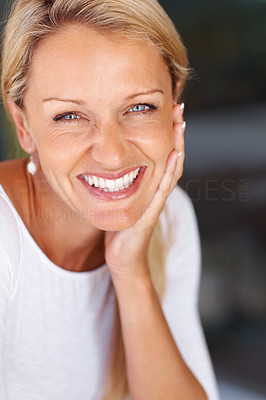 Buy stock photo Closeup portrait of a happy beautiful mature woman smiling