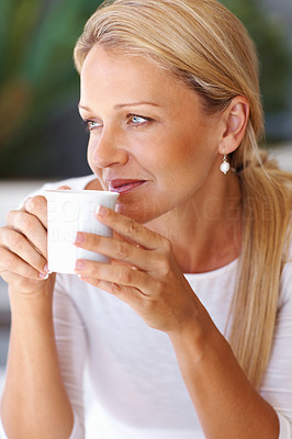 Buy stock photo Closeup portrait of a thoughtful beautiful mature woman drinking tea