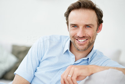 Buy stock photo Portrait of a casual young male relaxing at home - Indoor