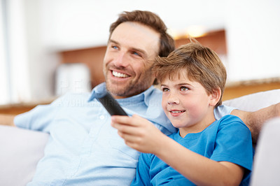 Buy stock photo Portrait of a happy young boy with his father watching television - Indoor