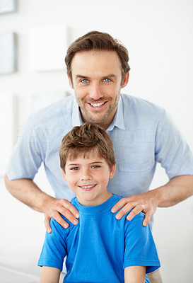 Buy stock photo Portrait of a cute little boy with his father smiling together - Indoor