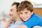 Happy young boy hugging his father