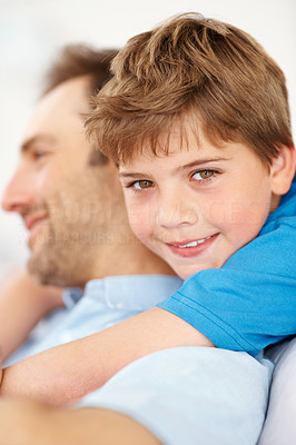 Buy stock photo Closeup portrait of a happy young child hugging his father from behind - Indoor