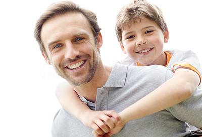 Buy stock photo Portrait of a happy man giving piggyback ride to his son - Outdoor