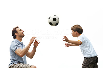 Buy stock photo Portrait of a small young child and his father playing soccer