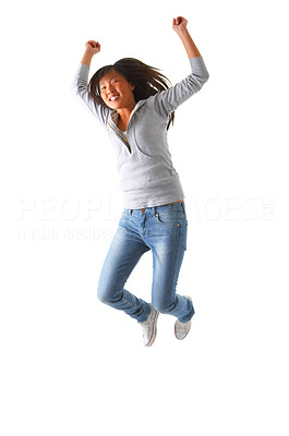 Buy stock photo One very happy energetic cute girl jumping into the air. Hooray!