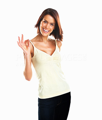 Buy stock photo Portrait of a young casual girl doing the okay sign isolated against white background