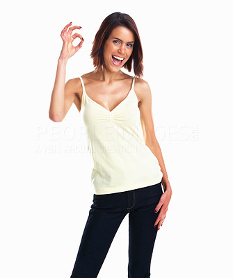 Buy stock photo Positive and cheerful young woman showing OK sign isolated against white background