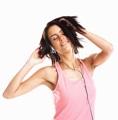 Buy stock photo Beautiful sensual young woman enjoying the music through headphones, isolated on white
