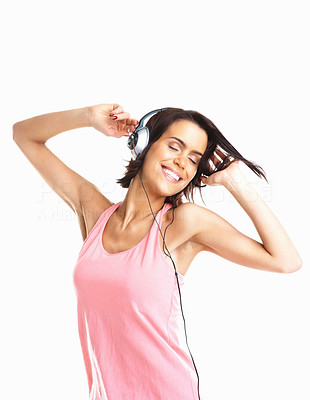 Buy stock photo Young woman enjoying music and moving to the beat against white background