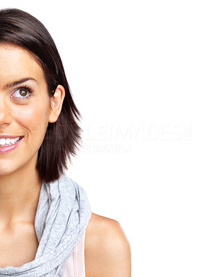 Buy stock photo Cropped cut image of a smiling young woman looking at copyspace against white background