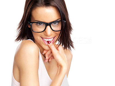 Buy stock photo Portrait of a naughty young female wearing glasses biting her nails against white background