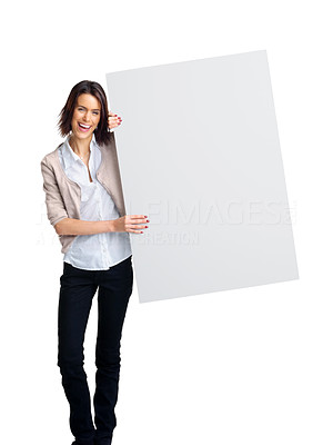 Buy stock photo Portrait of a smiling young woman with blank bill board over white background