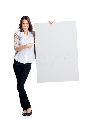 Buy stock photo Full length image of a happy young woman pointing her finger towards billboad over white background