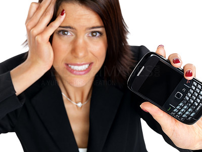 Buy stock photo Top view of a young businesswoman frustrated with her mobile not working against white background