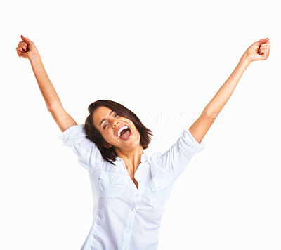 Buy stock photo Happy young woman raising hands in joy and freedom against white background