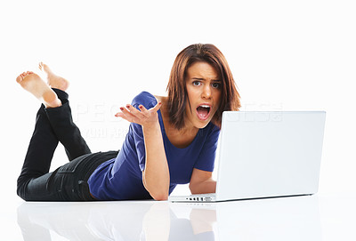 Buy stock photo Angry female student lying on floor while using against white background