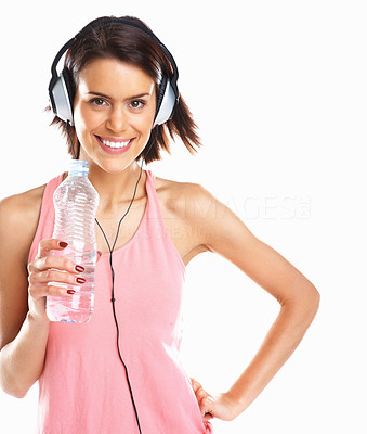 Buy stock photo Happy woman drinking water while listening to music in headphones against white background