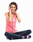 Relaxed young woman listening to music with eyes closed