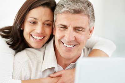 Buy stock photo Portrait of a happy mature couple using internet on laptop computer