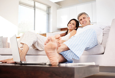 Buy stock photo Portrait of happy mature couple relaxing together in couch