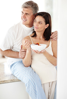 Buy stock photo Portrait of mature lady eating fruit salad with her husband and looking away - Copyspace