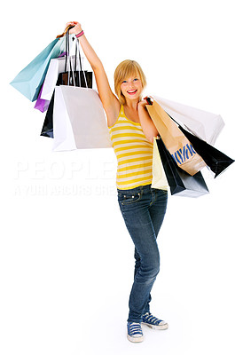 Buy stock photo Woman with shopping bags - Portrait of an attractive young woman holding several shopping bags.