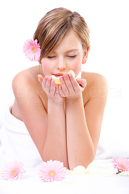Buy stock photo Young woman holding rose petals, smiling, eyes closed.