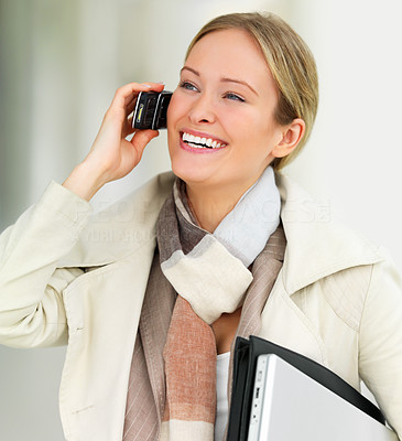 Buy stock photo Close-up portrait of young beautiful business woman using her cell phone and carrying laptop