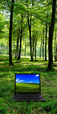 Buy stock photo A laptop in a lush green forest scene